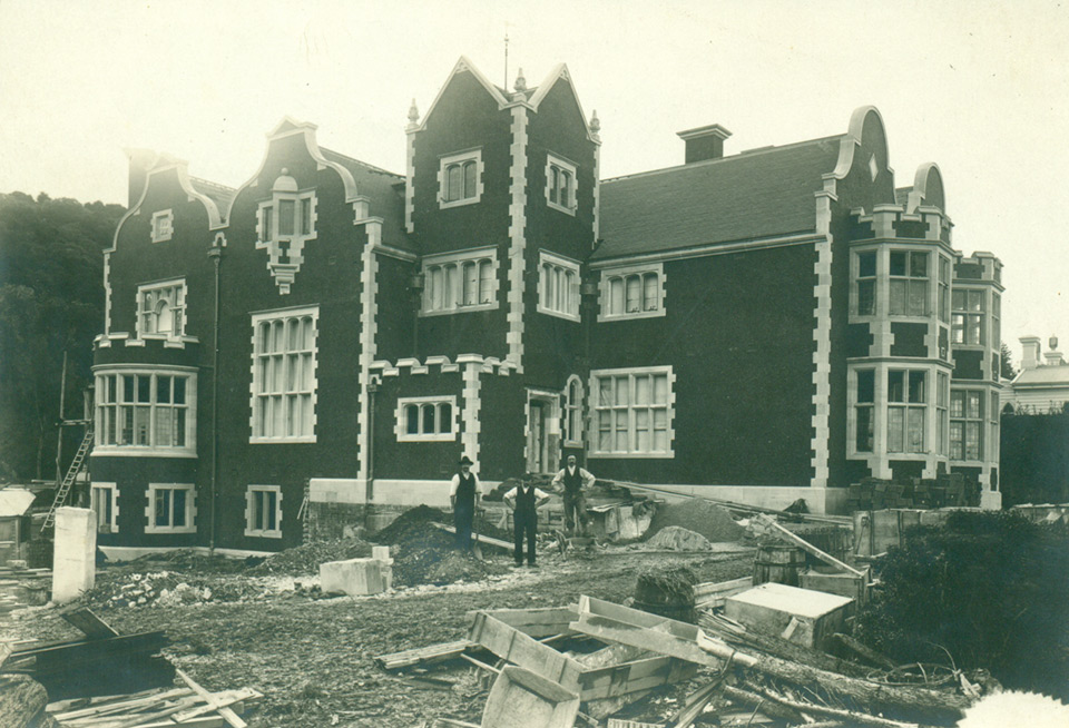 View from South East during construction with workmen.