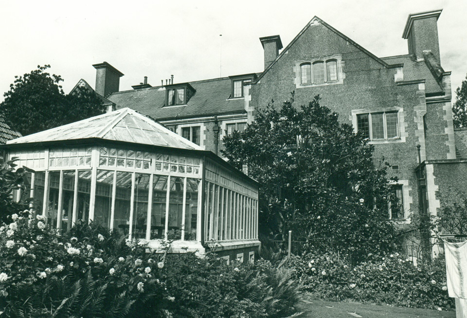 The original Glasshouse 1988, prior to demolition, house in background (Otago Daily Times, Dunedin).