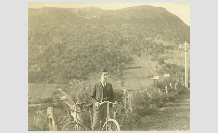 Edward Theomin. As a youth, with bicycle.