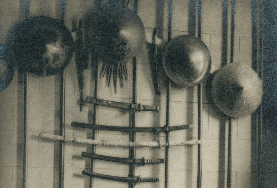 Vestibule with Japanese swords, pole spears and helmets. Photo taken at an earlier period.